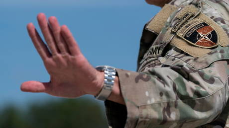 FILE PHOTO: US Army General Austin Scott Miller, the former top US commander in Afghanistan, waves upon his return, at Andrews Air Force Base, US on July 14, 2021.
