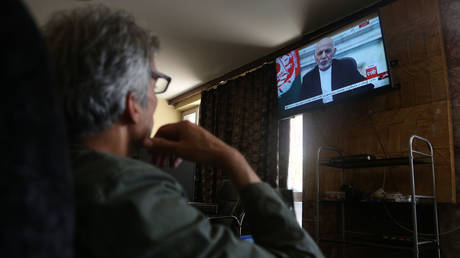 FILE PHOTO: Afghan president Mohammad Ashraf Ghani makes a televised address in Kabul, Afghanistan on August 14, 2021