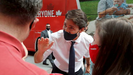 Canadian PM Justin Trudeau is shown being greeted by supporters in Ottawa on Sunday.
