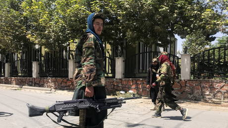 FILE PHOTO: Taliban forces keep watch inside Kabul, Afghanistan, on August 16, 2021.
