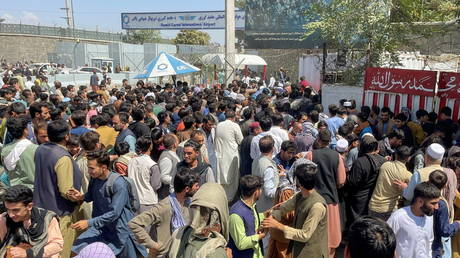 People try to get into Hamid Karzai International Airport in Kabul, Afghanistan, August 16, 2021