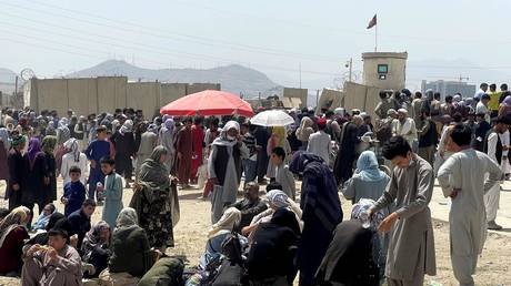 People wait outside Hamid Karzai International Airport in Kabul, Afghanistan August 17, 2021r