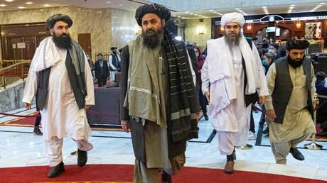 Mullah Abdul Ghani Baradar and other delegation members. © Reuters / Alexander Zemlianichenko