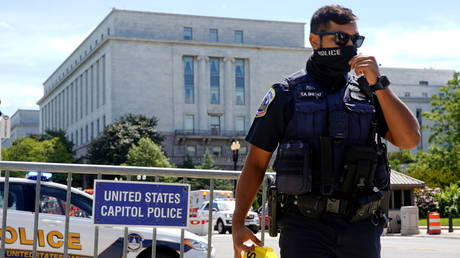 US Capitol Police officer mans a police barricade as police investigated a bomb threat near the US Capitol in Washington DC