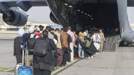 Evacuees boarding a C-17 Globemaster III at Hamid Karzai International Airport, Afghanistan, August 18, 2021