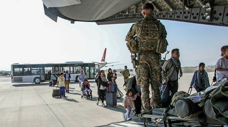 British citizens and dual nationals residing in Afghanistan board a military plane for evacuation from Kabul airport, Afghanistan, August 16, 2021