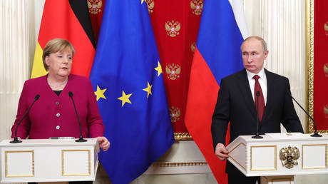 FILE PHOTO: Russian President Vladimir Putin and German Chancellor Angela Merkel attend a joint news conference following their meeting at the Kremlin in Moscow, Russia January 112020.