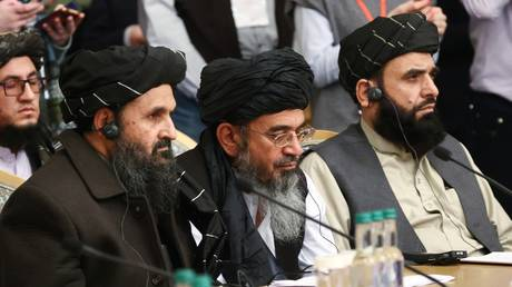 FILE PHOTO. Mullah Abdul Ghani Baradar, center, co-founder of the Taliban movement (terrorist organization, banned in Russia), attends an international peace conference for Afghanistan in Moscow, Russia. March 18, 2021