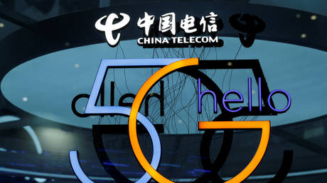 A sign of 5G is pictured at the booth of China Telecom during an internet expo at the fifth World Internet Conference (WIC) in Wuzhen, Zhejiang province, China, November 7, 2018.