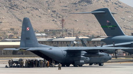 US Department of Defense service members defend aircraft at Hamid Karzai International Airport in Kabul, Afghanistan on August 17, 2021.