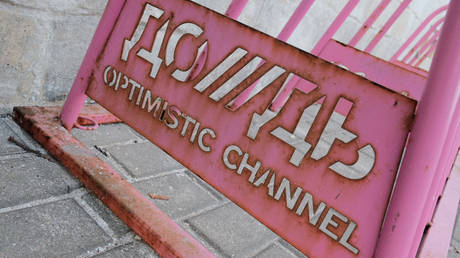 """A bicycle parking lot with the symbols of the TV channel """"Dozhd"""" in Moscow."""