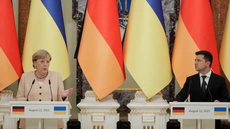 Ukrainian President Volodymyr Zelenskiy and German Chancellor Angela Merkel attend a joint news conference in Kiev, Ukraine on August 22, 2021.