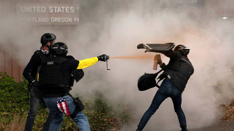 Proud Boys clash with Antifa during rival rallies in Portland, Oregon, US, August 22, 2021