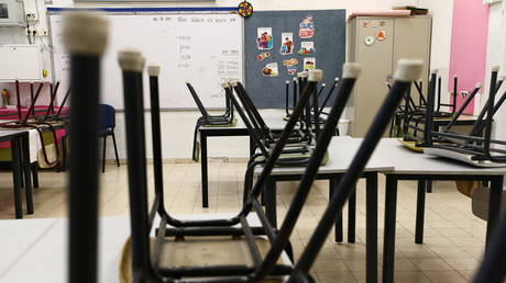 FILE PHOTO: An empty classroom is seen at a school in Jerusalem during the Covid-19 lockdown in Israel. © Reuters / Ammar Awad