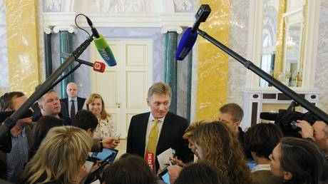 FILE PHOTO: Russian President's Press Secretary Dmitry Peskov, center, answers journalists' questions