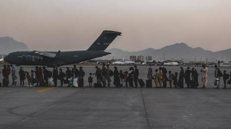 Evacuees wait to board a US Boeing C-17 Globemaster III during an evacuation at Hamid Karzai International Airport, Kabul, Afghanistan, Aug. 23. © U.S. Marine Corps photo by Sgt. Isaiah Campbell