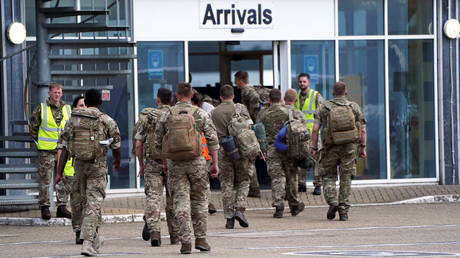 Members of the British armed forces arrive at RAF Brize Norton base after being evacuated from Kabul, in Oxfordshire, Britain on August 29, 2021.