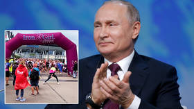 Putin hails 'truly great' inaugural Russian Ironman as grueling triathlon takes place in St Petersburg for the first time (VIDEO)