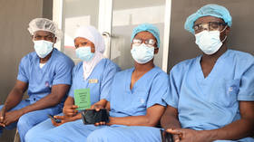 Nigerian doctors begin indefinite strike over payment and working conditions as Covid crisis continues