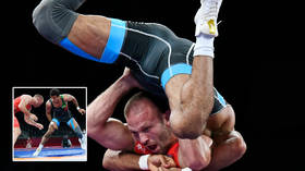 'On another level': Olympic wrestler downs opponent with flying squirrel attack as fans claim move 'deserves gold medal' (VIDEO)