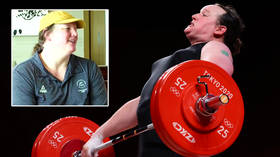 Transgender Olympic weightlifter concedes she is 'not sure' about being a role model as she admits retirement is looming (VIDEO)