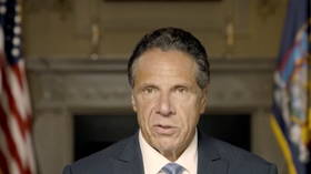 Defiant Cuomo shares montage of himself kissing people as explosive report says he sexually harassed 11 women
