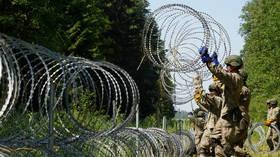 EU hopes suspension of Baghdad-Minsk flights will stem migrant flow to Lithuania as Vilnius debates giant border fence
