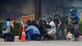 Thai protestors clash with police as demonstrators call for resignation of prime minister