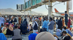 'World has gone Covid-mad': Afghans fleeing Taliban need negative PCR test to board now-suspended commercial flights out of Kabul