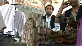 Afghan currency crashes amid turmoil as central bank chief flees Kabul