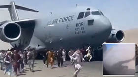 Like the Berlin Wall or the Twin Towers: footage of fleeing Afghans abandoned by US marks the end of an era for American supremacy