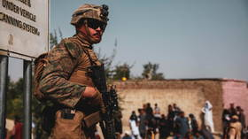 Afghan security forces member killed in gunfight with 'unknown assailants,' as US & German troops join battle at Kabul airport