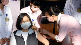 Taiwan's president gets first shot of homemade Covid-19 vaccine amid concerns over its rushed approval