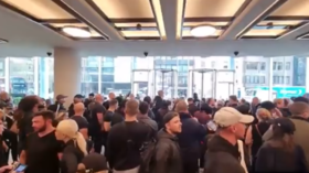 WATCH: Crowd protesting against Covid restrictions breaches ITN building