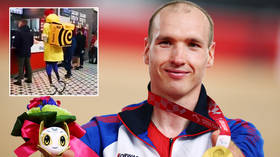 Delivering gold: Star who funded Paralympics trip with food courier job storms to world record glory before anthem farce (VIDEO)