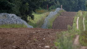 Polish military finishes first 6km of barbed wire wall on Belarusian border, minister says, to halt migrant influx