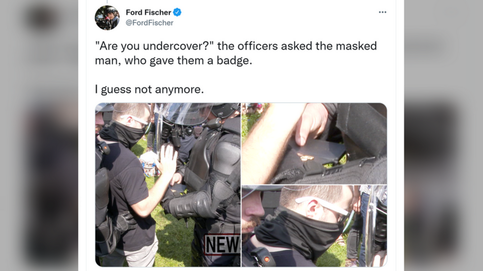 'Are you undercover?' WATCH riot cops at Justice for J6 rally detain masked man with a GUN… and a badge