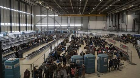 Evacuees from Afghanistan being processed inside a repurposed US maintenance hangar at Ramstein Air Base, Germany, August 30, 2021
