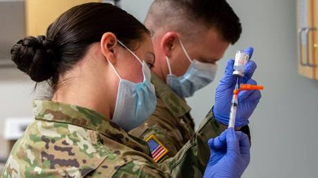 FILE PHOTO: Idaho National Guard troops prepare Covid-19 vaccine doses in an undated photo posted to the Guard's social media page.