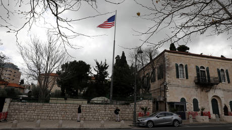 FILE PHOTO: An American flag flutters at the premises of the former United States Consulate General in Jerusalem. © Reuters / Ammar Awad