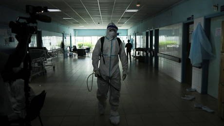 A health worker prepares to disinfect a hallway of a hospital amid Ebola scare in Abidjan, Ivory Coast on August 16, 2021.