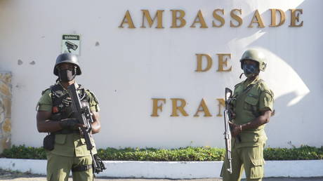 FILE PHOTO: Tanzanian security forces guard an entrance to the French embassy in Dar es Salaam, Tanzania, on August 25, 2021.