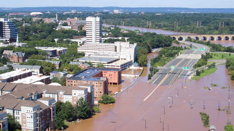 Roads in New Brunswick, New Jersey are seen covered in floodwaters after the remnants of Tropical Storm Ida brought heavy rain, flash floods and tornadoes to parts of the northeast, September 2, 2021.