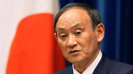 Japanese Prime Minister Yoshihide Suga speaks at an event in Tokyo, Japan, August 2021. © Kimimasa Mayama/Reuters