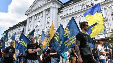 Activists of the National Corps and other patriotic organisations march along Volodymyrska Street, Kyiv, capital of Ukraine. © Olena Khudiakova/ Ukrinform/Barcroft Media via Getty Images