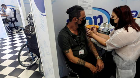 Israel resident receives third dose of Covid-19 vaccine in Rishon Lezion, Israel