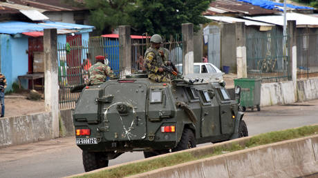 Members of the Armed Forces of Guinea drive through the central neighbourhood of Kaloum in Conakry on September 5, 2021.