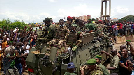 Residents cheer on army soldiers after the coup that ousted president Alpha Conde in Kaloum neighbourhood of Conakry, Guinea on September 6, 2021.
