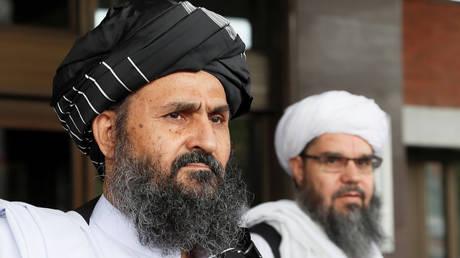 (L) Mullah Abdul Ghani Baradar. © Reuters / Evgenia Novozhenina