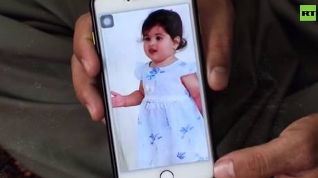 Emal Akhmadi's two-year-old daughter Malika was among the children killed in the American strike, said to be targeting ISIS-K. © RT